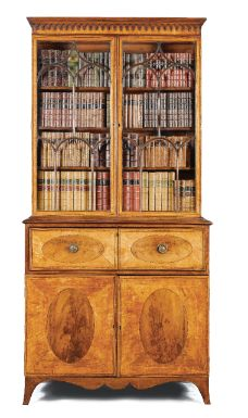 A George III satinwood and mahogany secretaire bookcase circa 1780 the secretaire drawer with eleven small drawers and pigeonholes, with a pair of cupboard doors below enclosing a sliding tray