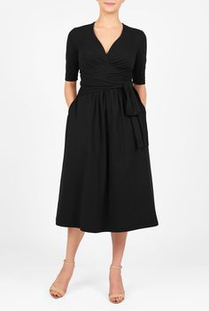 Angled empire waist banding and a low V-neck add chic sophistication to our sash tied cotton knit dress in a flowy silhouette.