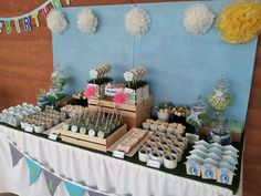 Puppy Party Dessert Table (love the doghouse favors and bone cookies!) #puppyparty #desserttable