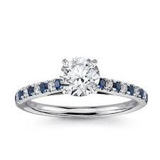 Wedding Ring. Love the sapphires around it!