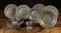 A Collection of Mainly Century Pewter Plates, a Pair of Century Pewter Salt Cellars and a Pair of Century Pewter soup plates stamped EDGAR & SON, 9 ins cms) in diameter. Pewter Plates, Silver Plate, Antique Pewter, Antique Decor, American History Lessons, Salt Cellars, Soup Plating, Colonial America, Vintage Kitchenware