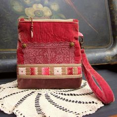 Wristlet pouch in velvet with vintage trim, lace and buttons.