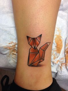 Origami tattoo of a fox, symmetrical and simple.