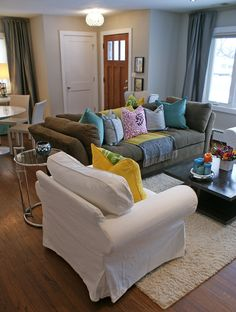 I like the neutral furniture with the pops of color in the pillows and accessories.  Imagine switching them out season to season for different color stories???  The possibilities are endless.