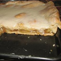 Almost like an apple pie, but baked in a inch sheet pan. Apple filling is baked between 2 layers of pastry, then covered with a creamy white frosting. Baked Apple Dessert, Apple Dessert Recipes, Dessert Bread, Apple Recipes, Dessert Bars, Just Desserts, Pumpkin Dessert, Cookie Recipes, Apple Sheet Cake Recipe