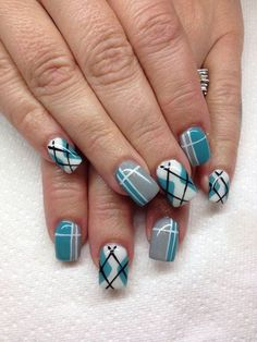 A cute and quirky looking plaid nails art design. The fresh color combination of white, green blue, gray and black colors are visually appealing and simply jump out of the nails.