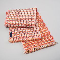 Our new 100% lambswool scarves are handwoven in studio in a double cloth  construction and are fully reversible with a different colour combination  on each side.  Our 'Casa' colourway was inspired by a trip to Cuba where we stayed in a  beautiful orange house in Vinales surrounded by pink flowers and banana  trees.  •Hand woven in studio by Heather  • 100% Lambswool  •Fully Reversible, different colour combination on each side  • Approx 180cm x 20cm   Hand wash with care in cool water…