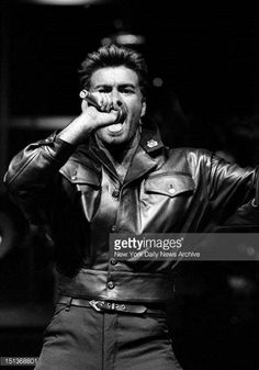 George Michael in concert at Madison Square Garden Wearing black leather over a bare chest and the words 'sex' abd 'one on one' flashed on a huge...
