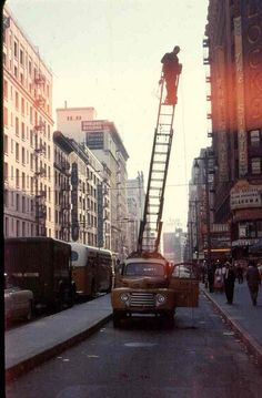 (1956) Wire Down for Air Conditioner Installation Atop Bullocks Store at Broadway and 7th St.
