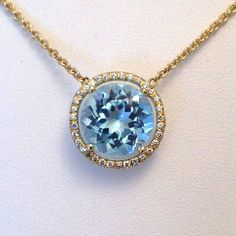 Twinkle Twinkle by Jane Taylor - round diamond frame necklace in 18K yellow gold with sky blue topaz