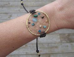 Gold Gemstone Dreamcatcher Adjustable Macrame Bracelet. $55.00, via Etsy.