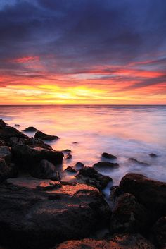 Sunset at Penanjong Beach, Brunei. Nature lovers can enjoy the ruffled waters of the South China Sea; cliffs, and fossil deposits can also be found here.