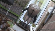 public pantyhose sexy wife in mini skirt and pantyhose tights bending over outdoors.