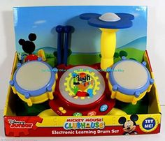 Disney Junior Mickey Mouse Clubhouse Electronic Learning Drum Set  This exclusive Mickey Mouse Clubhouse electronic drum set offers hours of fun for toddlers 24 months and older.  The three play modes, 'Play with Music', Drum Sound', and Counting 1-20′ are easily switched between using the three buttons on the front of the drum set.  Next to these three buttons is the on/off and volume switch, which allows for two volume levels.  The drum set is designed to teach children motor skill..