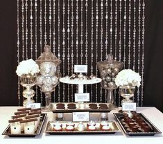 How to make a dessert bar.  I love the idea of varying heights by attaching the trays to something as simple as cups!
