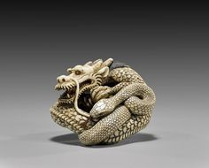 Lot:CARVED IVORY NETSUKE: Dragon & Snake, Lot Number:10, Starting Bid:$900, Auctioneer:I.M. Chait Gallery/Auctioneers, Auction:CARVED IVORY NETSUKE: Dragon & Snake, Date:11:00 AM PT - Nov 24th, 2013