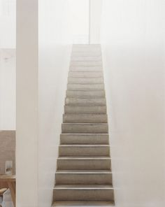 A concrete staircase connects the ground floor with John Pawson's office, located in the basement.