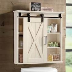 Trendy farmhouse rolling barn door bathroom cabinet allows you to utilize your space wisely without sacrific.Decorate Now, Pay Later with Country Door Credit! Bathroom Medicine Cabinet Mirror, Bathroom Barn Door, Bathroom Cupboards, Diy Barn Door, Bathroom Renos, Diy Cabinets, Lake Bathroom, Small Bathroom, Farmhouse Medicine Cabinets