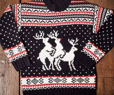 Get into the mood spirit of Christmas with the reindeer threesome sweater. This…