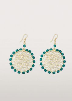Intricate iron wirework form the delicate filigree pattern at the centre of these pretty metal and beaded earrings. Dark turquoise coloured beads complete the look.