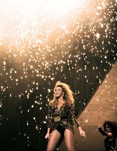 This is a picture of Beyonce at Glastonbury. This is a great picture as it shows how the performers can enjoy the event as much as the people that attend it. It is important that festivals get popular and well known acts as it may draw bigger crowds. This would be a good piece of marketing material as if this picture was to be printed in a magazine, readers would feel that Beyonce looks amazing and that they would want to be part of the event to witness such a show.