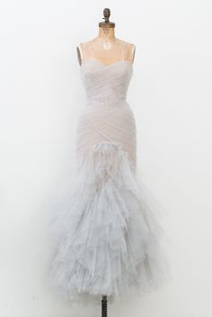 - Overview - To Purchase - Contract - DESCRIPTION: Soft blue Marchesa strapless gown with nude lining and features pleated tulle throughout bodice, layered ruffled skirt and concealed zip closure at c