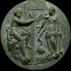 #Ancient  #greek #bronze Mirror , #hellenistic Period . #Aphrodite  #Satyr  #Eros  #Aphrodite leans on a pillar and offers a stick to a goose at Her right side .