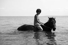 Riding in the sea.