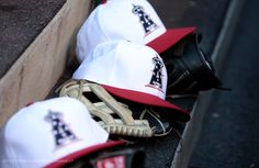 Teams wear patriotic red, white, and blue hats in honor of Independence Day