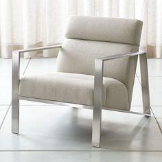 Bennetti fits comfortably into modern with architectural angles and a sleek mix of materials. Brushed stainless steel fashions an open minimalist frame with square arms and a dramatically sloped seat. Furniture Outlet, Custom Furniture, Metal Frame Chair, Chair Design Wooden, Cheap Office Chairs, Modern Armchair, Wood And Metal, Crate And Barrel, Side Chairs