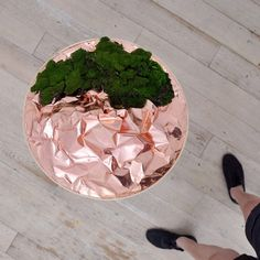 Floating islands made of crumpled copper and moss.