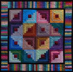 Amish Log Cabin quilt  I love the quilting on this otherwise simple quilt. Takes it from very nice to Wow! Nice use of colors too.