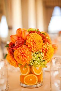 Autumn flower centerpiece... with orange dahlias, tulips, pin cushion protea, and mini green hydrangea