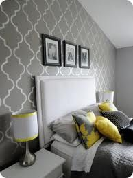 Grey and Yellow bedroom. I would like to do this with red accents instead of yellow.