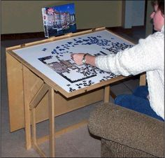 """Folding puzzle table. Cover keeps """"helpers"""" at bay. The dog will never eat another puzzle piece."""