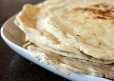 Cafe Rio home made tortillas - 2 cups white flour 1 1/2 tsp baking powder 1 tsp salt 2 tsp vegetable oil 3/4 c warm water Mix dry, mix wet, slowly combine. Knead & divide. Let sit 20 minutes. Knead. Let sit 10 minutes. Cook.