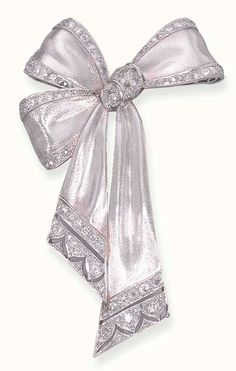 A DIAMOND-SET RIBBON BOW BROOCH The brushed white bow, with old mine-cut diamond trim, gathered by old European-cut diamonds, to the pierced terminals, circa 1928