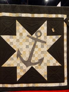 Lisa Bongean's anchor quilt made with her Lakeside Gatherings collection and quilted by Linda of the Quilted Pineapple. 2014 Fall Quilt Market - Houston.  Photo by A Quilting Life