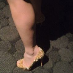 My brand new 5-inches Christian Louboutin stilettoes in Gold. Nice?