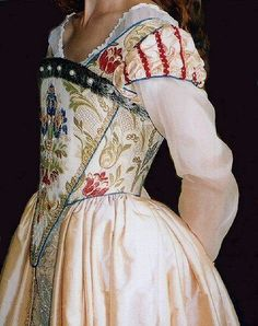 Elizabethan period costume - corseted elizabethan-shaped bodice constructed in an elaborate brocade, embellished with further beading and faux fur. The main skirt was in a deep cream silk, opening at the front to show a brocade panel, enhanced with pearls.