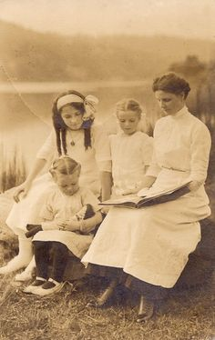 U.S. Real photo postcard. Photo taken on the bank of the Willamette River in Milwaukie, Oregon just south of Portland in 1912. Mother Elvah Reck and daughters Norma, Virginia and Fairy  Flickr by  sctatepdx