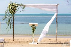 A simple rustic single sided gazebo using local white lotus and greenery