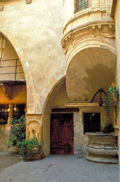"""Traboules in Lyon- Lyon is famous for its """"traboules,"""" secret passageways that connect parallel streets, like this one in the rue Juiverie. Step though a street doorway and you enter a maze of covered alleys which thread past Renaissance courtyards with staircases and romantic balconies."""