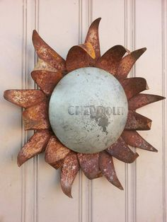 Hey, I found this really awesome Etsy listing at https://www.etsy.com/listing/177097112/chevy-hubcap-sunflower-or-sun-rusted