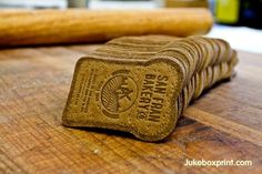 Bread Shaped Business Cards - Thick 45pt Brown Kraft card, blind letterpress and die-cut shape. By #jukeboxprint