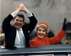 Ronald and Nancy Reagan waving from the limousine during the Inaugural Parade.Washington,DC.1/20/81.
