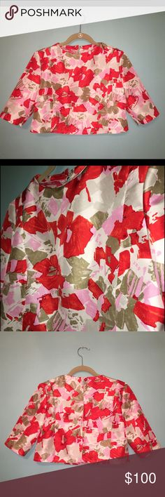 Floral Print Silk Taffeta Cropped Top Blouse Lovely all-over floral print cropped style blouse. Made from a silk taffeta fabric. Pieced together, seam line detail. Darts at bust. Slightly gathered, short sleeves. Keyhole in back with single button closure