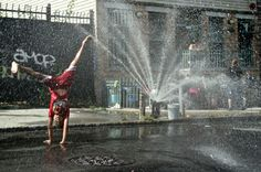 https://flic.kr/p/d5bL4d | 100 Days of Summer | Cartwheeling in the spray of an open fire hydrant in Bushwick, Brooklyn. Happiness can't get much simpler than that.  More in my series: 100 Days of Summer -  www.charleslebrigand.com www.twitter.com/le_brigand