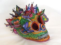 Day of dead pottery skull is handpainted in Mexico