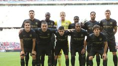 The starting line-up in the Audi Cup game against AC Milan in 2013